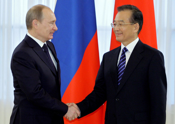 Premier Wen Jiabao shakes hands with his Russian counterpart Vladimir Putin on a visit to St. Petersburg on Tuesday.ALEXEY DRUZHININ / AFP